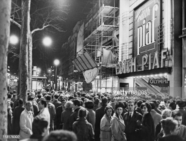 Crowds outside the Olympia theatre in Paris France waiting to see French singer Edith Piaf in the late 1950's