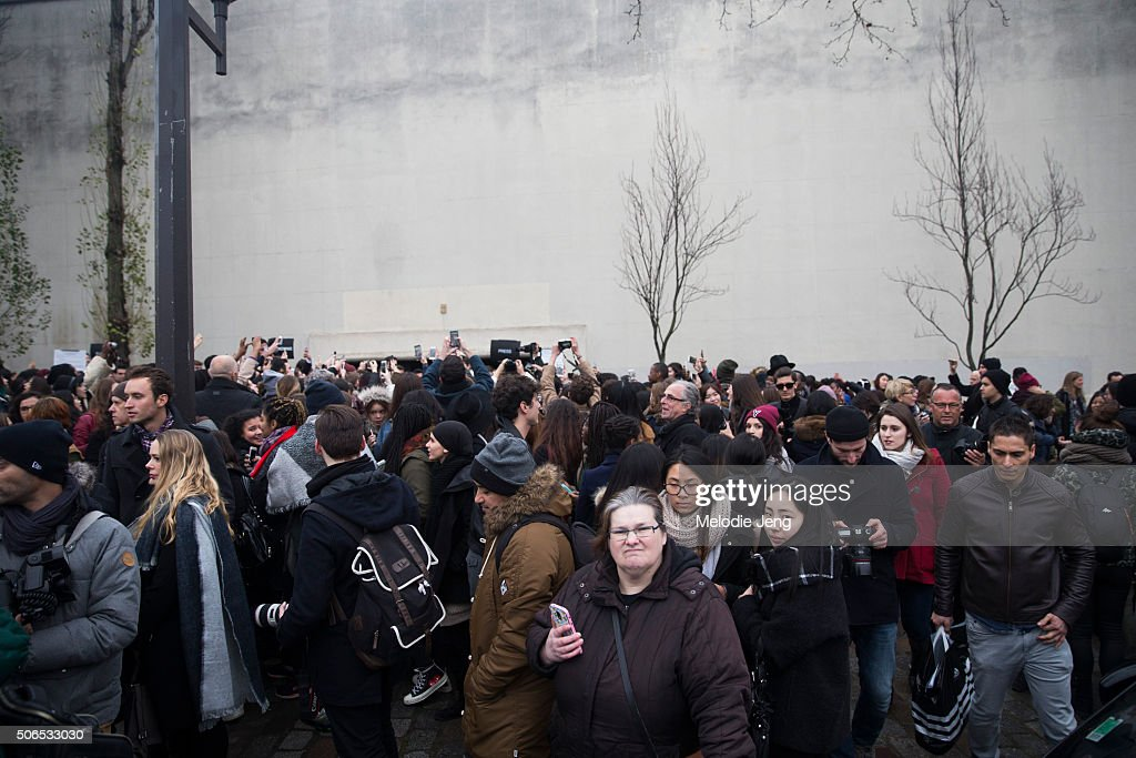 Crowds outsidet the Dior Homme show at Tennis Club de Paris on January 23, 2016 in Paris, France.