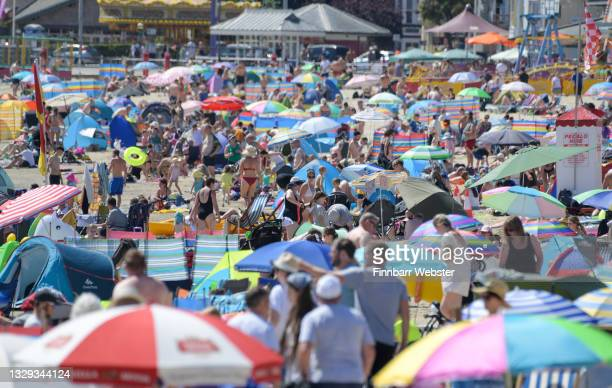 Crowds pack the beach on July 18, 2021 in Weymouth, England. A heat-health warning has been issued for England this weekend, with temperatures are...