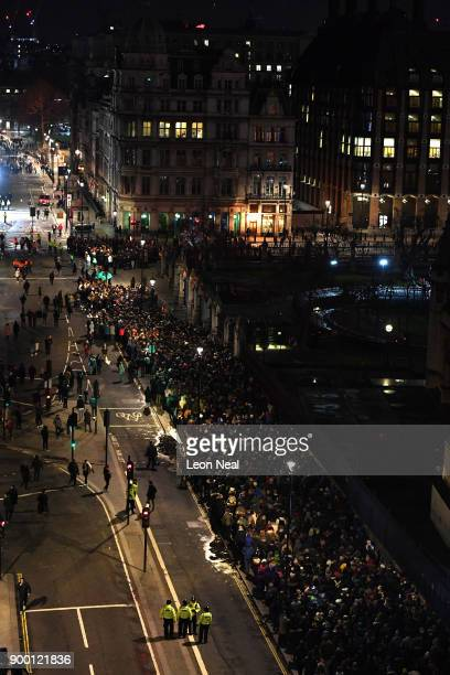 Crowds queue at Parliament Square to watch the fireworks show to ring in the near year on December 31 2017 in London England Crowds are lining the...