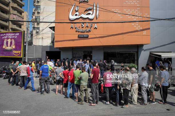 Crowds queue to buy bread at a local bakery in Beirut Lebanon on Saturday June 27 2020 Lebanese officials announced more measures to stabilize the...