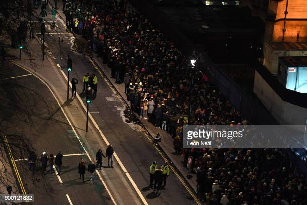 Crowds queue to get into the waterside position to watch the fireworks show to ring in the near year on December 31 2017 in London England Crowds are...