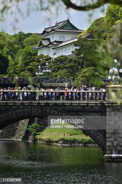 Crowds queue up at the Imperial Palace in the hope of seeing the new emperor make an appearance in Tokyo on May 4 2019 Emperor Naruhito urged Japan...