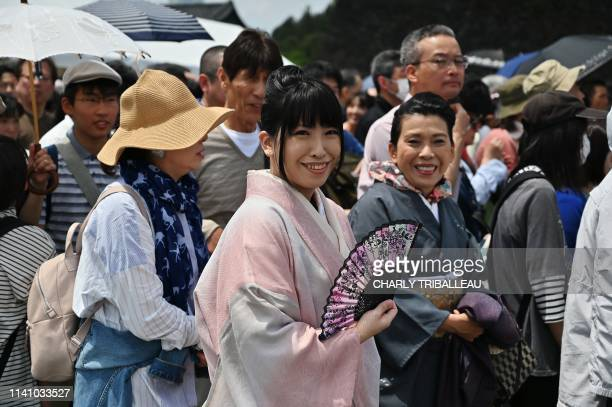 Crowds queue up outside the Imperial Palace in the hope of seeing the new emperor make an appearance in Tokyo on May 4 2019 Emperor Naruhito urged...