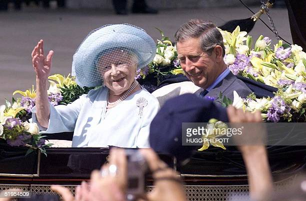 Crowds raise their hats to the The Queen Mother as she arrives at Buckingham Palace along side Prince Charles on her 100th birthday 04 August 2000...