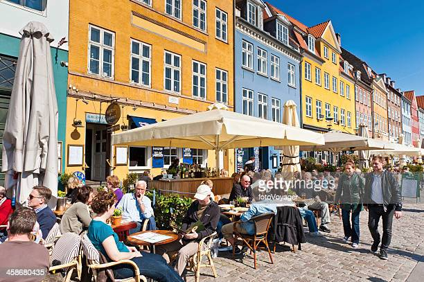 crowds relaxing sunny pavement cafes nyhavn copenhagen denmark - nyhavn stock pictures, royalty-free photos & images
