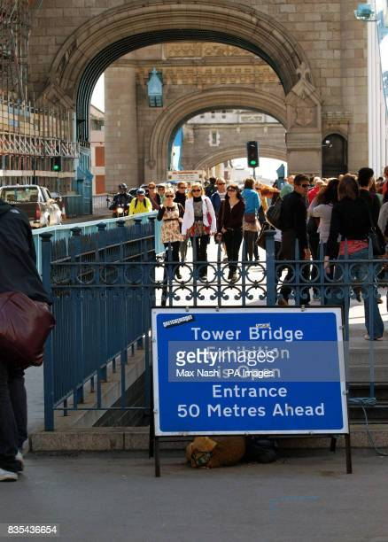 Crowds return to London's Tower Bridge after it was reopened following an elevator accident which left six people injured