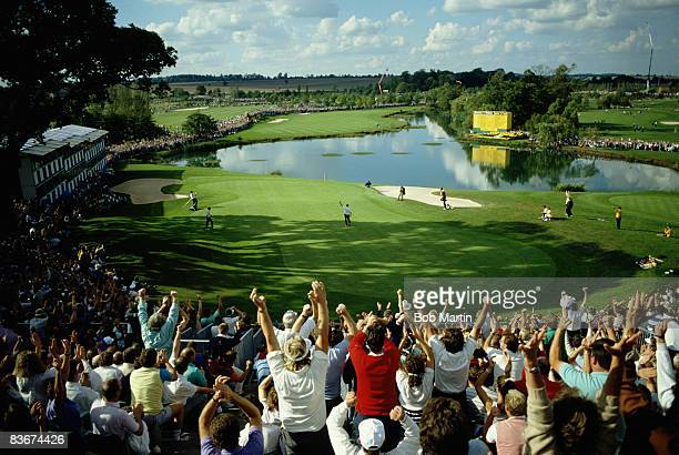 Crowds round the 18th green cheer Spanish golfer Severiano Ballesteros during a Ryder Cup match at The Belfry Warwickshire 24th September 1989 The...