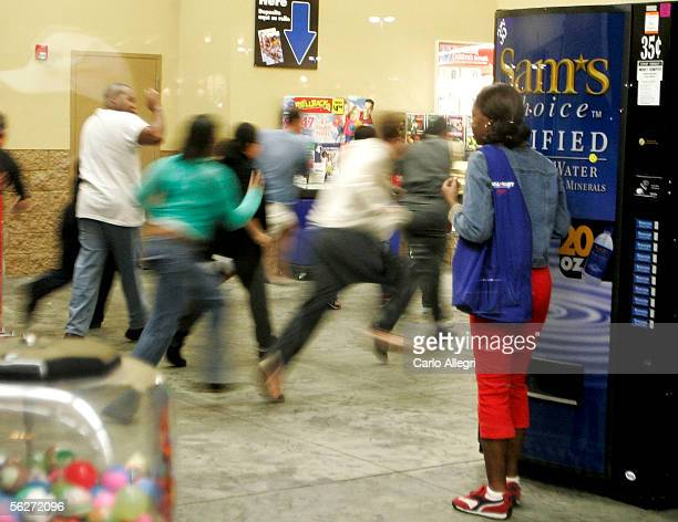 Crowds rush into a Walmart store as the doors open at 5am to scoop up good deals on heavily discounted merchandise on the day known as 'Black Friday'...