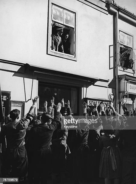Crowds salute German Nazi leader Adolf Hitler in Sankt Polten Austria 12th March 1938 Hitler is en route from Linz to Vienna where he will proclaim...