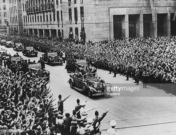 Crowds salute German Nazi leader Adolf Hitler on his arrival in Berlin from Munich 2nd October 1938