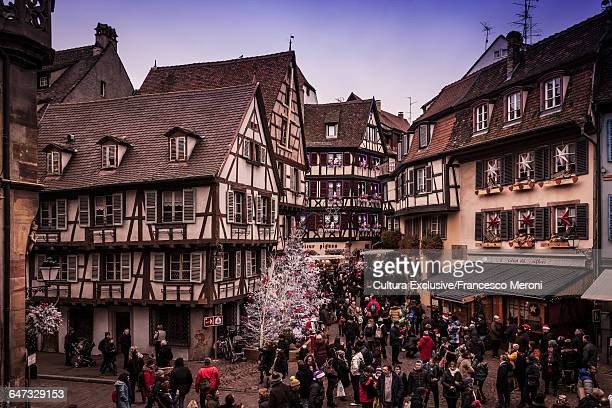 Crowds shopping at christmas market in town square, Colmar, France