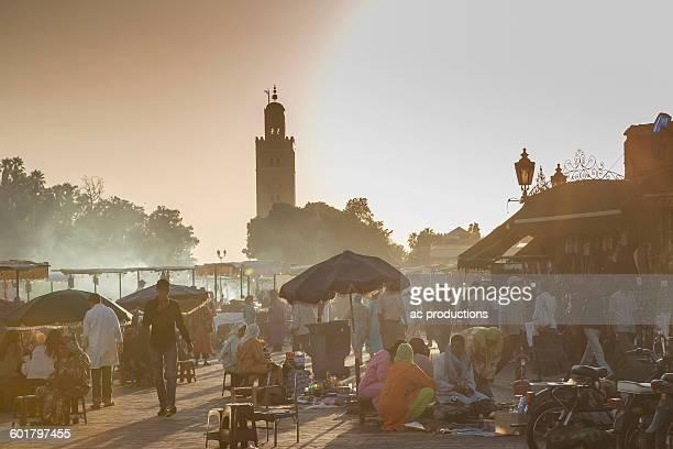 crowds shopping at outdoor market - nordafrika stock-fotos und bilder
