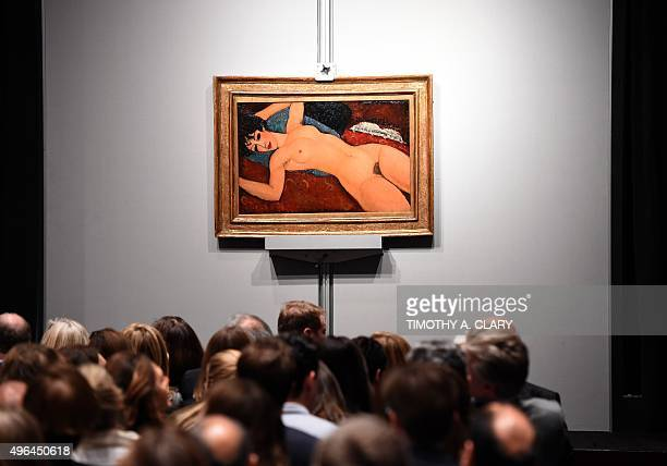 Crowds sit in front of Amedeo Modigliani's Nu couche during the Artist Muse A Curated Evening Sale November 9 2015 at Christie's New York November 9...