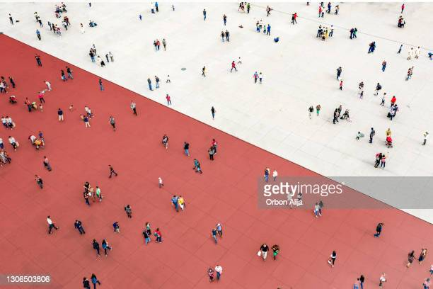 crowds standing on two separated zones - political party stock pictures, royalty-free photos & images