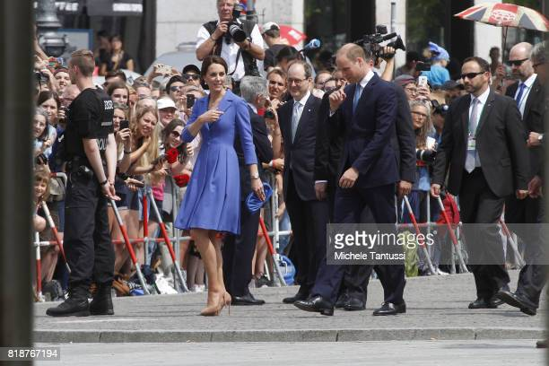 Crowds stands beside the road as Catherine Duchess of Cambridge and Prince William Duke of Cambridge visits the Brandenburg Gate on the first day of...