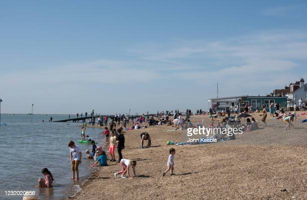 Crowds start to gather on the beach during the warm weather on March 30, 2021 in Southend, United Kingdom. Despite todays temperature heading towards...
