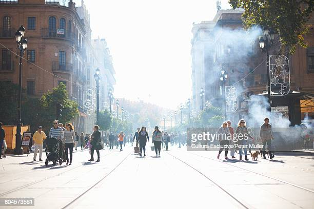 Crowds strolling on city street, Seville, Andalusia, Spain