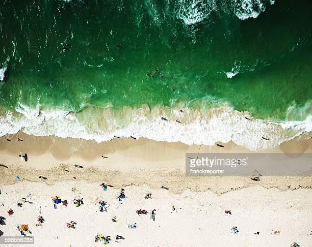 crowds sunbathing on the beach in miami