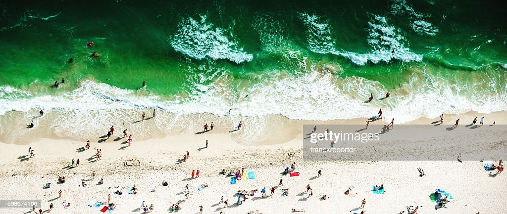 crowds sunbathing on the beach in miami : Stock Photo