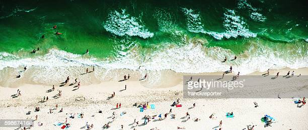 crowds sunbathing on the beach in miami
