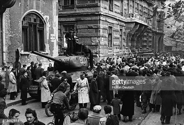 Crowds surround a captured Russian tank during the antiCommunist revolution in Hungary