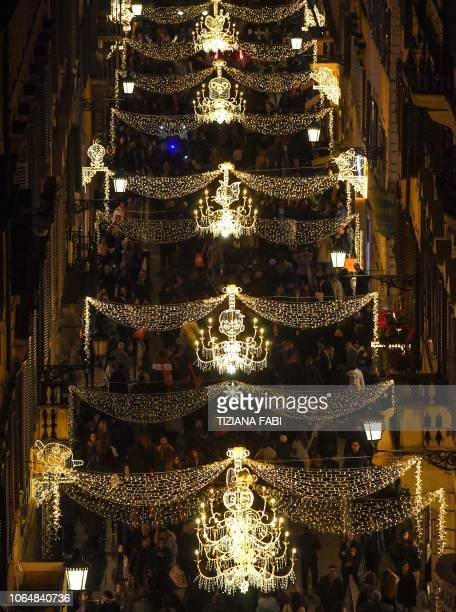 Crowds throng on Via Condotti in central Rome on November 24 2018 during the switching of a series of cartoonshaped Christmas lights