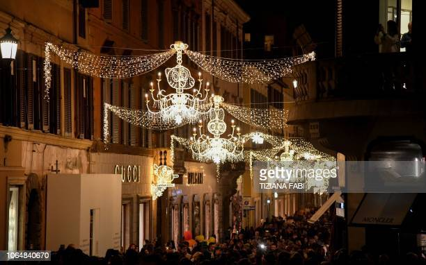 Crowds throng Via Condotti in central Rome on November 24 2018 during the switching of a series of cartoonshaped Christmas lights