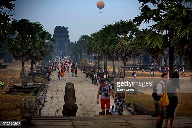 Crowds visiting Angkor Wat with Angkor Wat Balloon in distance The balloon is 1k west of the Angkor WatThe German made helium balloon is attached to...