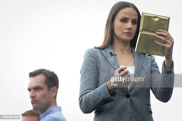Crowds wait for Prince William, Duke of Cambridge and Catherine, Duchess of Cambridge to arrive at the Cambridge Town Hall on April 12, 2014 in...