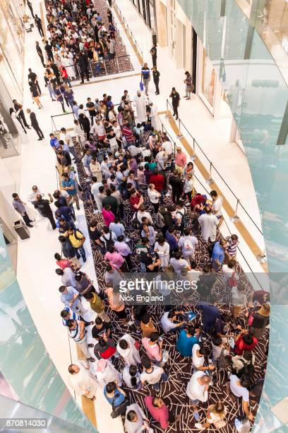 Crowds wait for the iPhone X launch outside the Apple store Dubai Mall