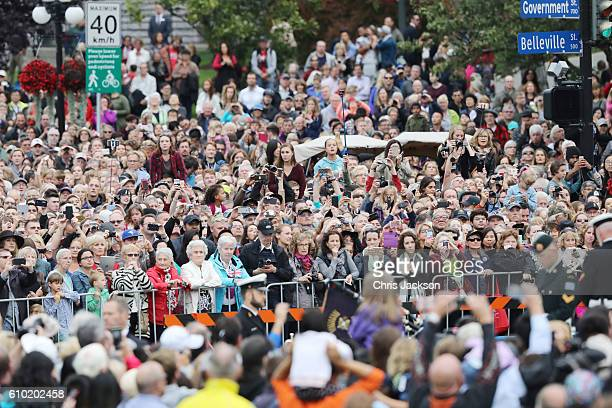 Crowds wait for the Royal Family to arrive at the Official Welcome Ceremony for the Royal Tour at the British Columbia Legislature on September 24,...