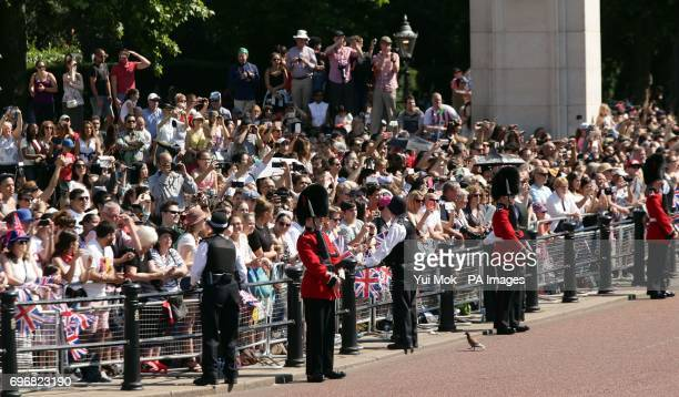Crowds wait for the Royal procession to make its way down The Mall from Buckingham Palace, central London to Horse Guards Parade for the Trooping the...