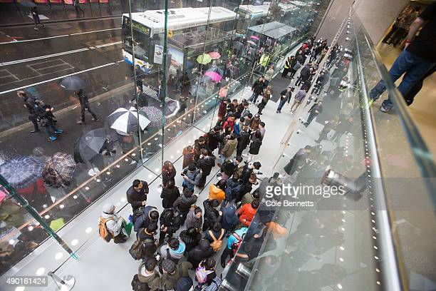 Crowds wait in anticipation for the release of the iPhone 6s and 6s Plus at Apple Store on September 25 2015 in Sydney Australia Some eager iPhone...