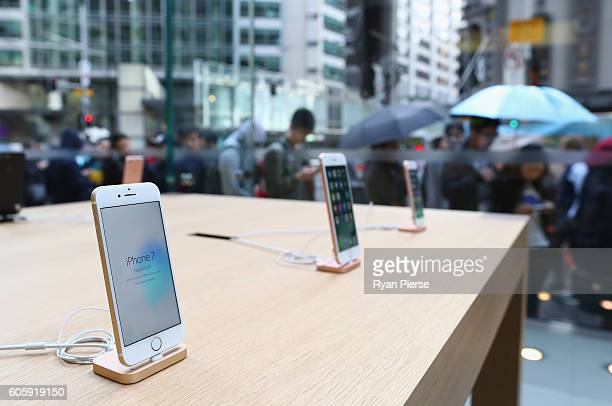 Crowds wait in anticipation for the release of the iPhone 7 at Apple Store on September 16 2016 in Sydney Australia Apple's latest iPhone features a...