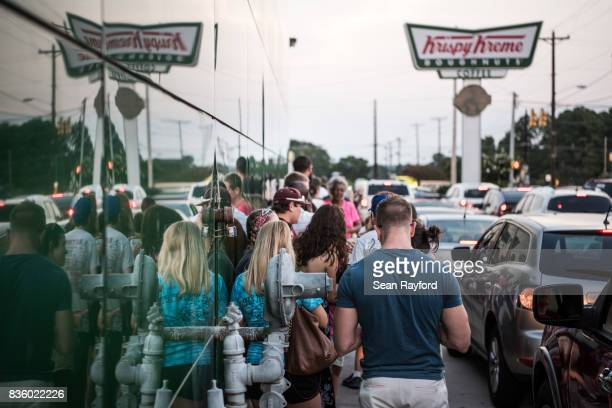 Crowds wait in line for eclipse donuts August 20 2017 in Columbia South Carolina Columbia is one of the prime destinations for viewing Monday's solar...