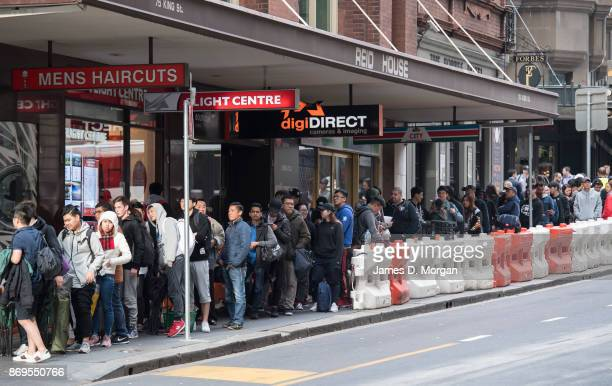 Crowds wait in line for the Australian release of the iPhone X at the Apple Store on November 3 2017 in Sydney Australia Apple's latest iPhone...