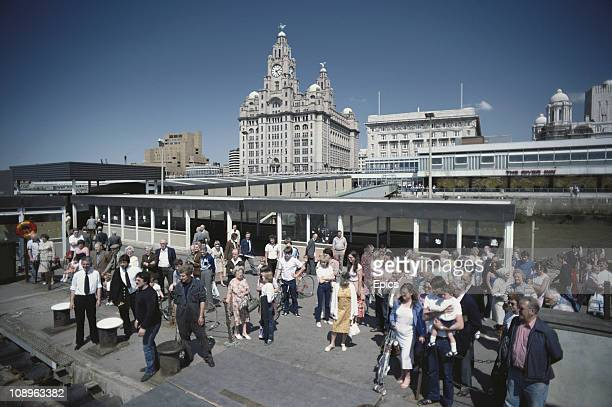 Crowds wait to board a Birkenhead ferry to cross the river Mersey Liverpool June 1982