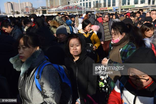 Crowds wait to enter a railway station in Beijing on February 10 as travellers depart the capital ahead of the Lunar New Year China is in the midst...