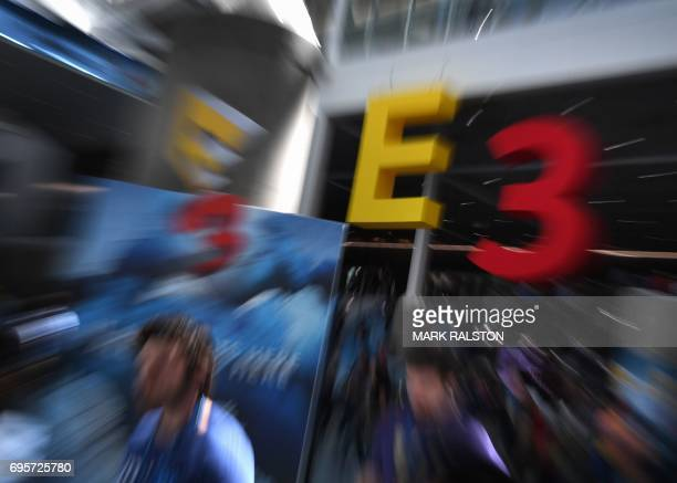 Crowds wait to enter the Los Angeles Convention center on day one of E3 2017, the three day Electronic Entertainment Expo, one of the biggest events...