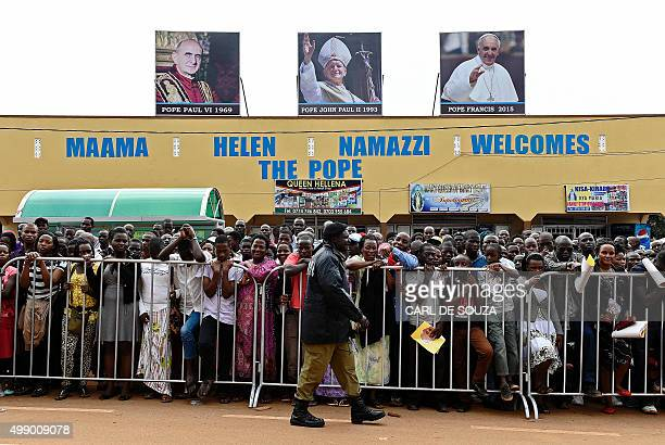 Crowds wait to greet the Pope at Namugongo Martyrs' Shrine where he will be holding a mass on November 28 2015 Pope Francis arrived in Uganda on...
