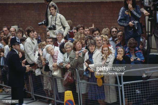 Crowds waiting for a glimpse of Princess Diana and her newborn son, Prince Harry, outside St Mary's Hospital, London, 16th September 1984.