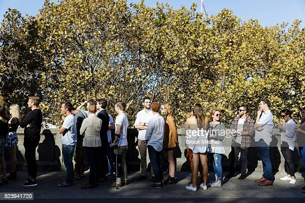 Crowds waiting to play Twoup at the Gelnmore Hotel n the Rocks on April 25 2016 in Sydney Australia Twoup is a traditional Australian gambling game...