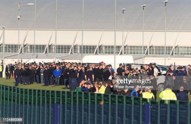 Crowds waits to see Airbus' BelugaXL supertransporter aircraft arrive at Hawarden Aerodrome in Broughton where it is due to carry out ground tests