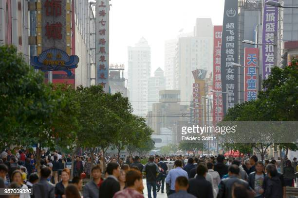 Crowds walk on Nanjing Road. The street is the main shopping district of the city and one of the world's busiest shopping districts in Shanghai on...