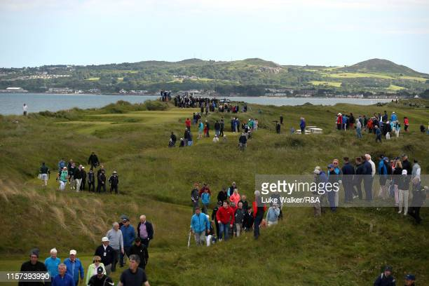 Crowds walk on the golf course during day five of the RA Amateur Championship at Portmarnock Golf Club on June 21 2019 in Portmarnock Ireland
