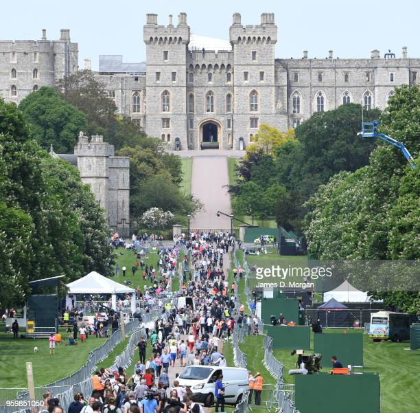 Crowds walk on the Long Walk in the park beside the castle on May 18, 2018 in Windsor, England. The Berkshire town, west of London will host the...