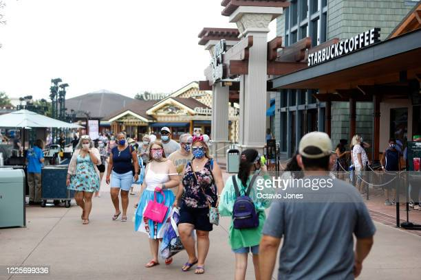 Crowds walk through Disney Springs shopping and dining complex at Walt Disney World on July 8 2020 in Lake Buena Vista Florida The theme park is...