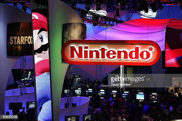 Crowds walk through the Nintendo exhibit on opening day of the 10th annual Electronic Entertainment Expo on May 12, 2004 in Los Angeles, California....