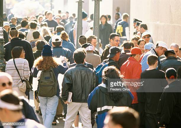 crowds walking and lingering, urban setting - lingering stock pictures, royalty-free photos & images